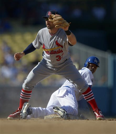 Cardinals beat Dodgers 5-2 with 3-run 12th