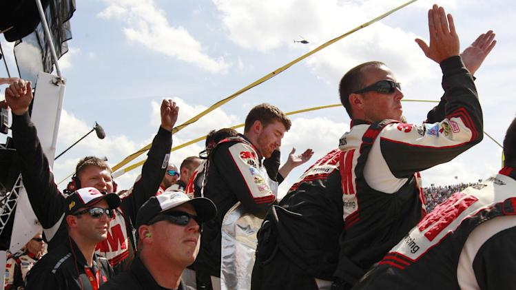 Sprint Cup Series driver Greg Biffle's pit crew celebrate his win in the NASCAR Quicken Loans 400 auto race at Michigan International Speedway, Sunday, June 16, 2013 in Brooklyn, Mich. (AP Photo/Carlos Osorio)