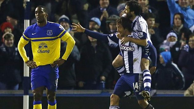 West Bromwich Albion's Diego Lugano (bottom L) celebrates his goal against Everton with Claudio Yacob (Reuters)