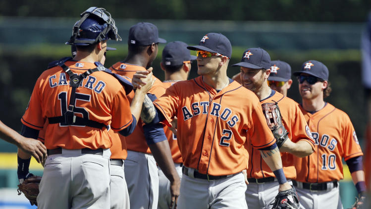 Houston Astros right fielder Brandon Barnes leads the team during their post game handshakes after defeating the Detroit Tigers 7-5 in a baseball game in Detroit, Wednesday, May 15, 2013. (AP Photo/Carlos Osorio)