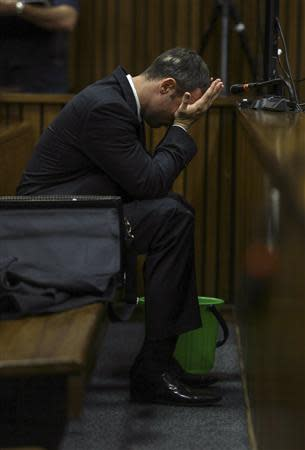 Olympic and Paralympic track star Oscar Pistorius listens during testimony at the North Gauteng High Court in Pretoria