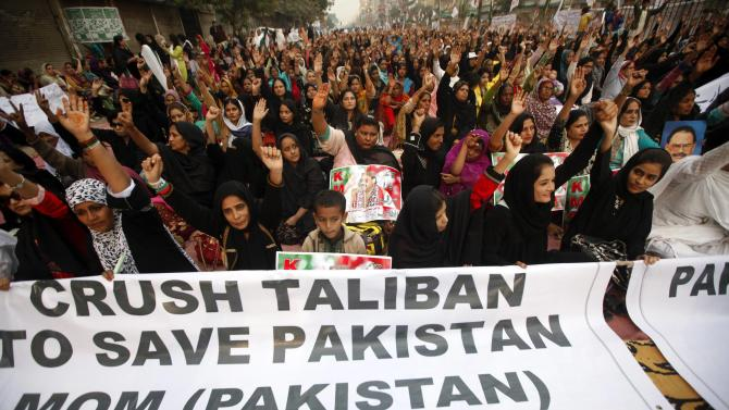 Supporters of Pakistan's Muttahida Quami Movement political party chant slogans to condemn the Taliban attack on the Army Public School in Peshawar, during national solidarity rally Karachi