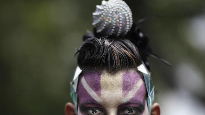A person wearing face paint and eye contacts attends a gay pride parade in Caracas, Venezuela, Sunday, June 30, 2013. Gays, lesbians and transgenders are participating in gay pride parades worldwide in late June as part of annual demonstrations for equal rights and against discrimination. (AP Photo/Ariana Cubillos)