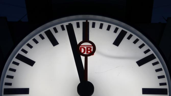 Deutsche Bahn sign is seen in a clock at a train station in Munich