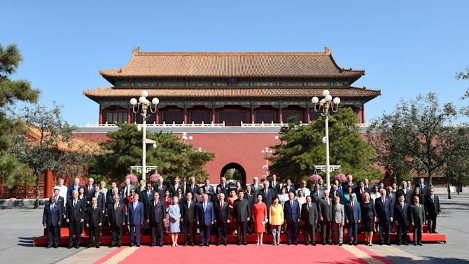 Nation leaders pose for a group photo ahead of a military parade to mark the 70th anniversary of the end of World War Two, in Beijing