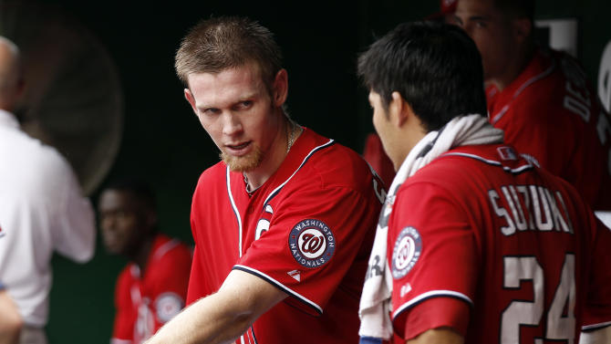 Washington Nationals starter Stephen Strasburg, left, talks with catcher Kurt Suzuki after pitching the sixth inning of a baseball game against the St. Louis Cardinals at Nationals Park, Sunday, Sept. 2, 2012, in Washington. Strasburg was relieved after completing the sixth inning and the Nationals won 4-3. (AP Photo/Alex Brandon)