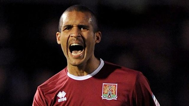 Clarke Carlisle has criticised players who have failed to explain their reasons for not backing the anti-racism T-shirt campaign