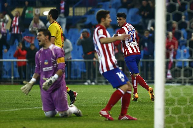 Atletico's Hector, right, celebrates his goal during a Copa del Rey soccer match between Atletico de Madrid and Sant Andreu at the Vicente Calderon stadium in Madrid, Spain, Wednesday, Dec. 18, 20