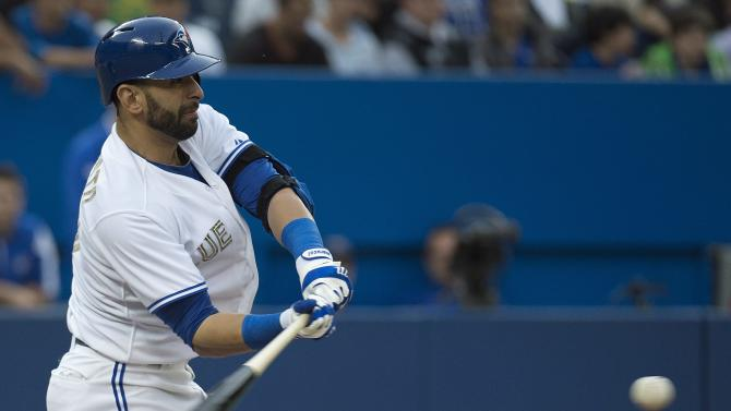 Toronto Blue Jays right fielder Jose Bautista hits a double against the Atlanta Braves during third inning interleague baseball action in Toronto on Monday, May 27, 2013. (AP Photo/The Canadian Press, Nathan Denette)