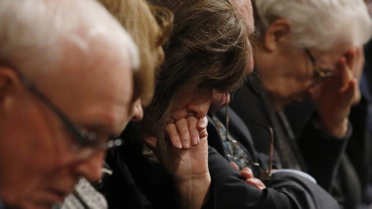 Friends and relatives react during a service of remembrance to mark the 25th anniversary of the Lockerbie air disaster in London