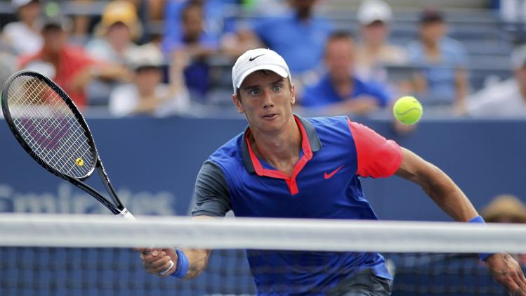 Andrey Kuznetsov of Russia hits a return to Andy Murray of Britain during their match at the 2014 U.S. Open tennis tournament in New York