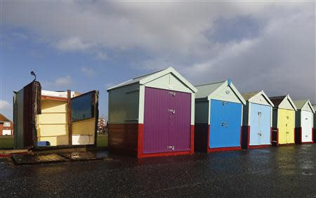 A beach hut has been overturned by strong winds during storms that battered Britain at Brighton in south east England