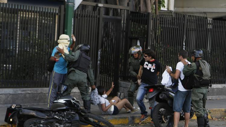 National Guards detain anti-government protesters after a demonstration against Nicolas Maduro's government at Altamira square in Caracas