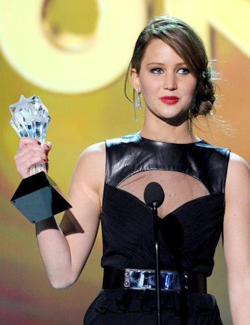 Jennifer Lawrence shows off one of her two 18th Annual Critics' Choice Awards for best actress.