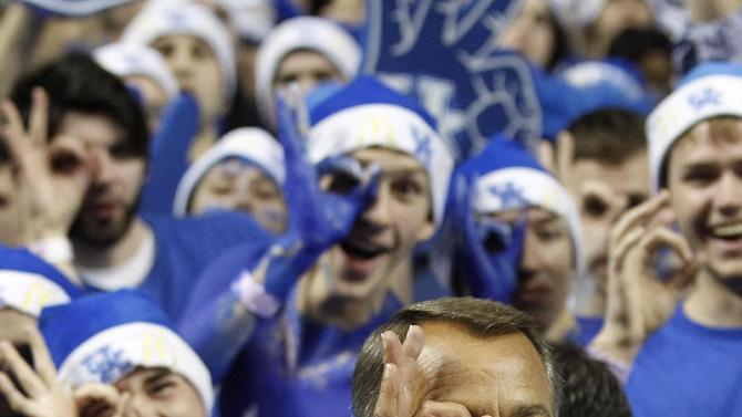 House Speaker John Boehner of Ohio makes the three-point goggles gesture before an NCAA college basketball game between Kentucky and North Carolina in Lexington, Ky., Saturday, Dec. 3, 2011. (AP Photo/James Crisp)