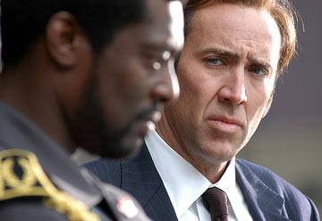 Eamonn Walker and Nicolas Cage in Lions Gate Films' Lord of War