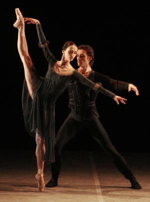 FILE - A Tuesday, May 22, 2007 file photo showing Russia's Svetlana Lunkina and Ruslan Skvortsov performing at a gala of the Prix Benois de la Danse competition at the Bolshoi Theater in Moscow. Lunkina, who is now in Canada, has sent a letter to the Bolshoi asking it to extend her leave because she fears to return to Russia after receiving threats. Lunkina's move follows an attack earlier this month on Bolshoi's artistic director Sergei Filin, who received heavy burns after an unknown assailant threw acid at his face. (AP Photo/Mikhail Metzel, File)