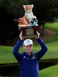 THOUSAND OAKS, CA - DECEMBER 08: Zach Johnson poses with the trophy after the final round of the Northwestern Mutual World Challenge at Sherwood Country Club on December 8, 2013 in Thousand Oaks, California. (Photo by Stephen Dunn/Getty Images)