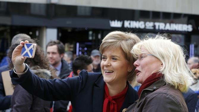 Nicola Sturgeon leader of the Scottish National Party takes a selfie photograph with a supporter during an election visit to Kirkcaldy