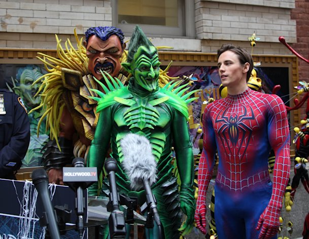 Robert Cuccioli, portraying the Green Goblin, center, and Reeve Carney, portraying Spider-Man, right, are shown along with an actor dressed as villan Kraven the Hunter from the Broadway musical, &quot;Spider-Man: Turn Off the Dark,&quot; during a news conference held to offer tips on keeping kids safe this Halloween, Thursday, Oct. 25, 2012 in New York. Representatives from the city&#39;s fire and police departments and actors from the cast reminded parents to examine all Halloween candy and never eat any unwrapped treats, ensure children wear flame-retardant costumes and masks that never impeded their ability to see and hear, and avoid strangers or unfamiliar houses. (AP Photo/Mark Kennedy)