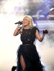 "Carrie Underwood performs ""Two Black Cadillacs"" at the 40th Anniversary American Music Awards on Sunday, Nov. 18, 2012, in Los Angeles. (Photo by Matt Sayles/Invision/AP)"