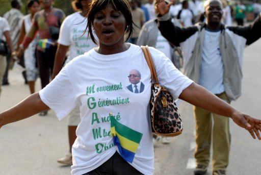 &lt;p&gt;A supporter of Gabon&#39;s main opposition leader Andre Mba Obame, celebrates his return. Obame arrived in Libreville after 14 months in France, saying the International Criminal Court would look into a 2009 &quot;massacre&quot; at Port-Gentil.&lt;/p&gt;