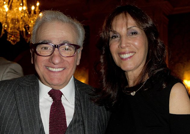 U.S director Martin Scorsese, and Olivia Harrison pose for photographs during a pre Bafta drinks reception for Scorsese at Claridges in London, Friday, Feb. 10, 2012. The pair worked together on the documentary of George Harrison; Living in the Material World. Scorsese receives the Bafta Fellowship award during the ceremony on Sunday. (AP Photo/Joel Ryan)