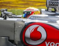 McLaren Mercedes driver Lewis Hamilton of Britain steers his car during the Canadian Formula One Grand Prix at the Circuit Gilles Villeneuve in Montreal. A delighted Hamilton made it a magnificent record seven different winners in seven races this year on Sunday when he drove with flawless speed and control to win the Canadian Grand Prix
