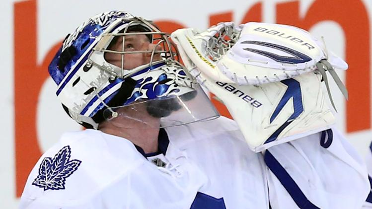 Toronto Maple Leafs goaltender James Reimer looks up as he celebrates the defeating the Ottawa Senators 4-1 after  an NHL game in Ottawa Saturday April 20, 2013. (AP Photo/The Canadian Press, Fred Chartrand)
