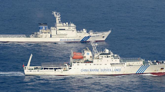 Ships of China Marine Surveillance and Japan Coast Guard sail side by side near disputed islands, called Senkaku in Japan and Diaoyu in China, in the East China Sea Tuesday afternoon, Sept. 18, 2012. The disagreement between the two countries escalated last week when the Japanese government said it was purchasing some of the islands from their private owner. (AP Photo/Kyodo News) JAPAN OUT, MANDATORY CREDIT, NO LICENSING IN CHINA, HONG KONG, JAPAN, SOUTH KOREA AND FRANCE