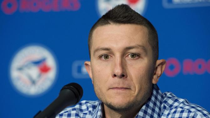 Toronto Blue Jays' newly-acquired shortstop Troy Tulowitzki speaks to reporters during a news conference in Toronto on Wednesday, July 29, 2015.  Tulowitzki and right-handed reliever LaTroy Hawkins were acquired from the Colorado Rockies. (Darren Calabrese/The Canadian Press via AP) MANDATORY CREDIT