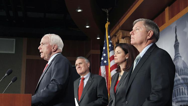 Sen. John McCain, R-Ariz., ranking Republican on the Senate Armed Services, left, speaks during a news conference on Capitol Hill in Washington, Wednesday, Dec. 14, 2011, to announce an effort to replace the defense sequester mandated as a result of the Supercommittee's failure. From left are, McCain, Senate Minority Whip Jon Kyl of Ariz., and Senate Armed Services Committee members, Sen. Kelly Ayotte, R-N.H., and Sen. Lindsey Graham, R-S.C.   (AP Photo/J. Scott Applewhite)