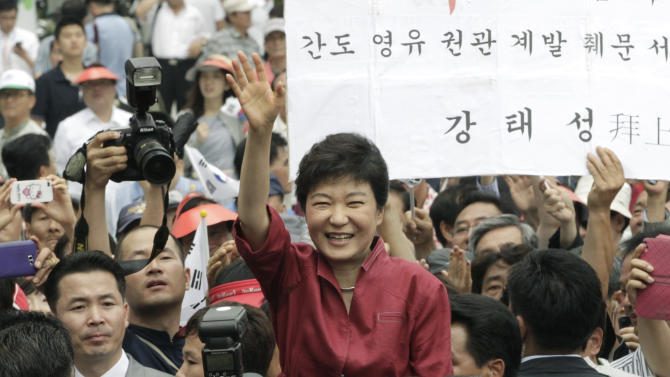 """FILE - In this Tuesday, July 10, 2012 file photo, Park Geun-hye, a former leader of the conservative ruling Saenuri Party, waves to her supporters during a ceremony to announce her plan to run for president in Seoul, South Korea. Park served five terms in the legislature and earned the nickname """"Queen of Elections"""" for her ability to win tight races. She only narrowly lost in presidential primaries five years ago to current conservative President Lee Myung-bak, whose single term ends in February. Park attempts to become the country's first female president and keep the government in conservative hands in the Dec. 19, 2012 election.  (AP Photo/Ahn Young-joon, File)"""