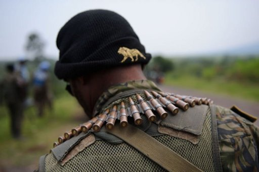 <p>A soldier from the Armed Forces of the Democratic Republic of the Congo (FARDC) stands guard on the road between Goma and Rutshuru. UN troops in the Democratic Republic of Congo have stationed a dozen tanks around Goma city in the east where rebels have recently seized territory, said an AFP photographer on the scene.</p>