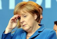 German Chancellor Angela Merkel gestures during the last campaign meeting of her ruling party CDU candidate for the elections in North Rhine-Westphalia (NRW) state in Duesseldorf on May 11. Voters in a crucial German state emphatically punished Merkel&#39;s pro-austerity party, awarding her main centre-left rivals a major boost ahead of 2013 national elections