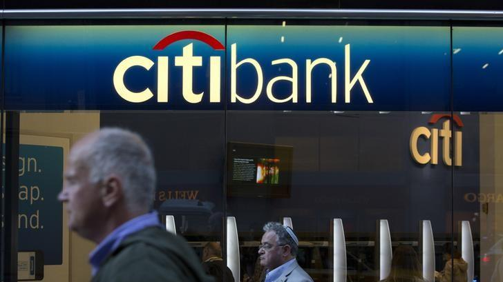 People walk past a Citibank branch in New York