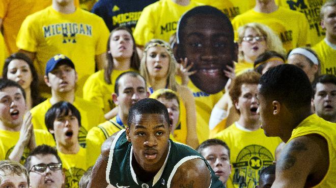 Michigan State guard Keith Appling, left, handles the ball while defended by Michigan guard Trey Burke (3) in the first half of an NCAA college basketball game, Sunday, March 3, 2013, at Crisler Center in Ann Arbor, Mich. (AP Photo/Tony Ding)