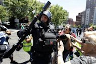 <p>A Spanish riot policeman clashes with a protester during a coal miners' demonstration in Madrid on Wednesday. Spanish unions have announced a national day of protest as workers rain down criticism on a new 65-billion-euro ($80-billion) austerity package.</p>