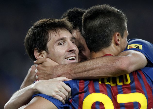 Lionel Messi celebrates with Barcelona team-mates