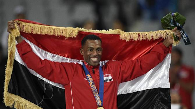 Gold medallist Adnan Taess Akkar celebrates on the podium for the Asian Games men's 800m in Incheon on October 1, 2014