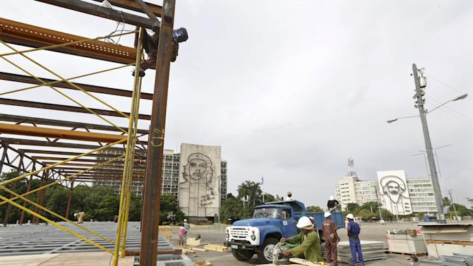 Workers construct a platform where Pope Francis will celebrate mass on at the Revolution Square in Havana
