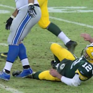 Green Bay Packers quarterback Aaron Rodgers upset with Detroit Lions defensive tackle Ndamukong Suh
