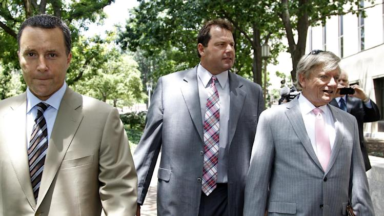 Former Major League Baseball pitcher Roger Clemens, center, and his attorneys, Rusty Hardin, right, and Michael Attanasio arrive at federal court in Washington, Wednesday, June 13, 2012.  (AP Photo/Haraz N. Ghanbari)