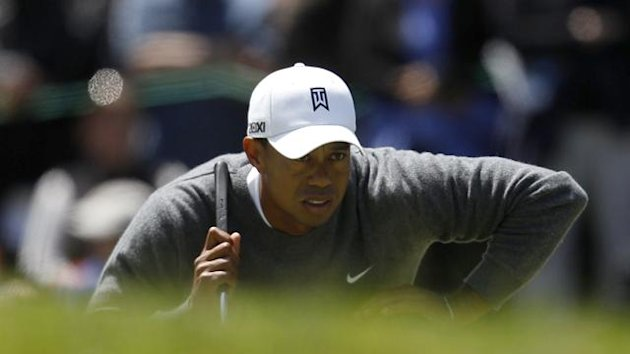 Tiger Woods of the U.S. looks at his putt on the sixth green during the first round for the 2012 U.S. Open golf tournament on the Lake Course at the Olympic Club in San Francisco, California June 14, 2012