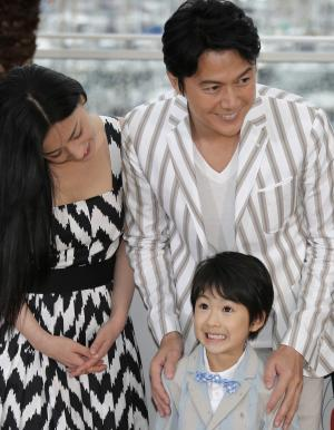 From left, actors Machiko Ono, Masaharu Fukuyama and Keita Ninomiya pose for photographers during a photo call for the film Like Father, Like Son at the 66th international film festival, in Cannes, southern France, Saturday, May 18, 2013. (AP Photo/Lionel Cironneau)