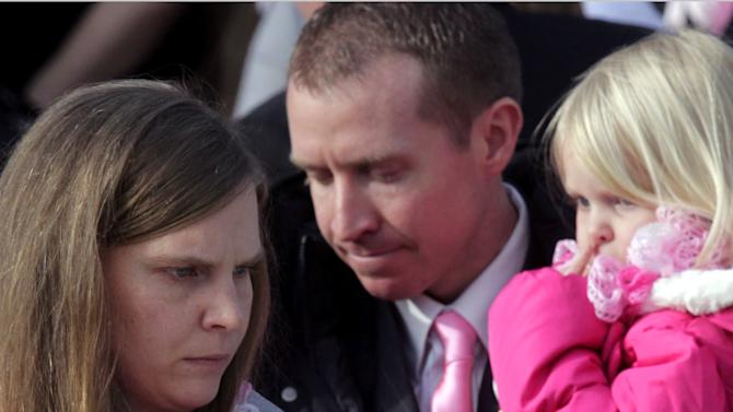 EMILIE PARKER, 6: Alissa Parker, left, and her husband, Robbie Parker, center, carry their daughters Samantha, 3, and Madeline, 4, following funeral services for their daughter Emilie, on Saturday, Dec. 22, 2012, at The Church of Jesus Christ of Latter-day Saints, in Ogden, Utah. (AP Photo/Rick Bowmer)