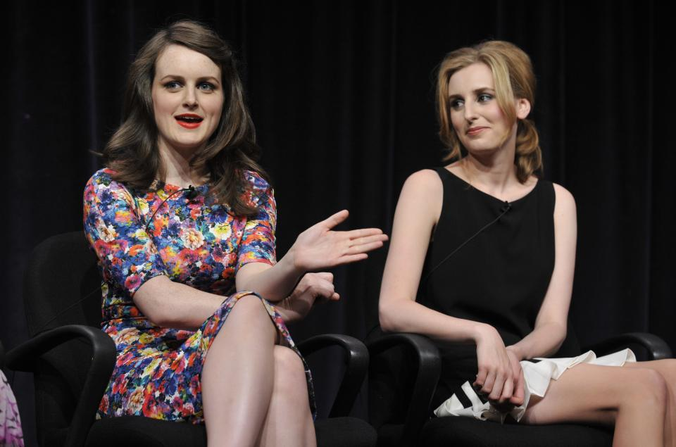 "Sophie McShera, left, and Laura Carmichael, cast members in the Masterpiece series ""Downton Abbey,"" take part in a panel discussion on the show at the PBS Summer 2013 TCA press tour at the Beverly Hilton Hotel on Tuesday, Aug. 6, 2013 in Beverly Hills, Calif. (Photo by Chris Pizzello/Invision/AP)"