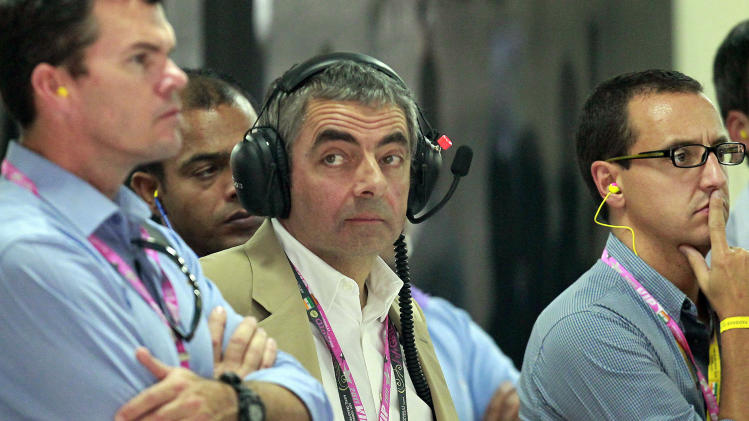 British actor Rowan Atkinson visits McLaren garage during Indian Formula One Grand Prix at the Buddh International Circuit in Noida, 38 kilometers (24 miles) from New Delhi, India Sunday, Oct. 30, 2011. (AP Photo/Eugene Hoshiko, Pool)