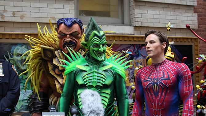 "Robert Cuccioli, portraying the Green Goblin, center, and Reeve Carney, portraying Spider-Man, right, are shown along with an actor dressed as villan Kraven the Hunter from the Broadway musical, ""Spider-Man: Turn Off the Dark,"" during a news conference held to offer tips on keeping kids safe this Halloween, Thursday, Oct. 25, 2012 in New York. Representatives from the city's fire and police departments and actors from the cast reminded parents to examine all Halloween candy and never eat any unwrapped treats, ensure children wear flame-retardant costumes and masks that never impeded their ability to see and hear, and avoid strangers or unfamiliar houses. (AP Photo/Mark Kennedy)"