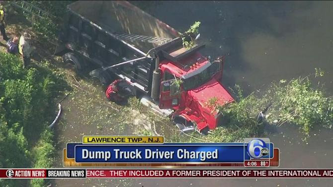 Dump truck driver charged after fatal crash that sent car into lake